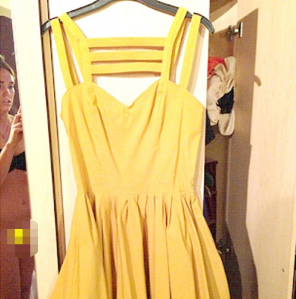 Blonde girl accidentally appears naked on ebay